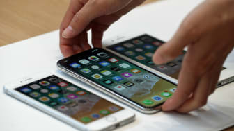 CUPERTINO, CA - SEPTEMBER 12:(L-R) The new iPhone 8, iPhone X and iPhone 8S are displayed during an Apple special event at the Steve Jobs Theatre on the Apple Park campus on September 12, 201