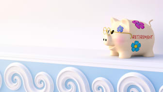 """picture of a piggy bank with """"retirement"""" written on the side of it"""