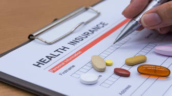 picture of health insurance form with pills on it