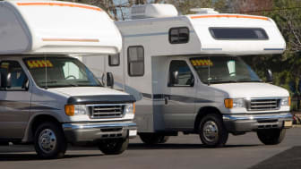 RVs for sale on the lot of an RV dealer