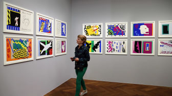 """A woman looks at Henri Matisse's """"Jazz"""" series at a gallery in Frankfurt."""