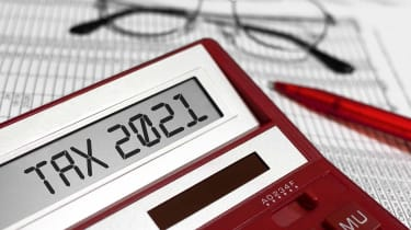 """picture of a calculator with """"tax 2021"""" on its screen"""