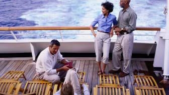 Passengers enjoy a cruise ship