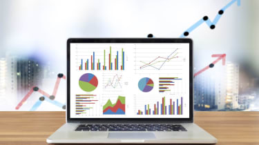 Laptop on wooden table showing charts and graph, Analysis Business Accounting,Statistics Concept.