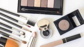 Makeup products with lipstick,makeup brushes, eye shadows, blushers, cosmetic. Woman desktop