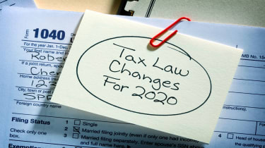 "picture of post-it note saying ""tax law changes for 2020"" on a tax form"
