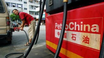 GUANGZHOU, CHINA - AUGUST 26:(CHINA OUT) A driver fills his car at a PetroChina gas station on August 26, 2005 in Guangzhou of Guangdong Province, China. The nation's largest oil and gas prod