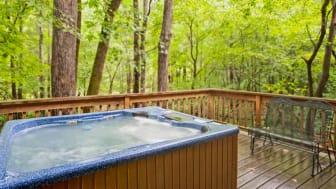 A hot tub on a deck.