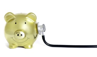 A piggy bank with a stethoscope