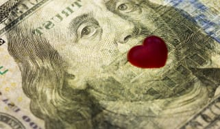 photo illustration of $100 bill with heart