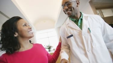 Physician Shaking Hands with Visitor