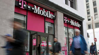 SAN FRANCISCO, CA - APRIL 24:Pedestrians walk by a T-Mobile store on April 24, 2017 in San Francisco, California. T-Mobile will report first quarter earnings today after the closing bell.(Pho