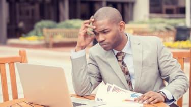 Busy man analyzing company financial report balance sheet statement