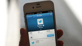 LONDON, ENGLAND - NOVEMBER 07:In this photo illustration, the Twitter logo and hashtag '#Ring!' is displayed on a mobile device as the company announced its initial public offering and debut