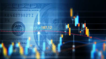 Financial data analysis graph showing market trends over one hundred American dollar bill on a digital display. Selective focus. Horizontal composition with copy space.