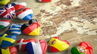 Map of Europe and hearts with flags of european countries. Travel EU concept. 3d