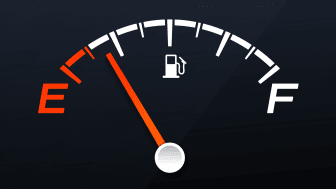 The needle on a car's gas gauge nears empty.