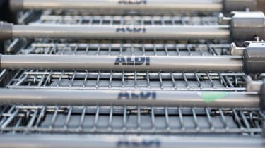 BRISTOL, ENGLAND - NOVEMBER 18:Aldi shopping trolleys are stacked outside a branch of the supermarket on November 18, 2015 in Bristol, England. As the crucial Christmas retail period approach