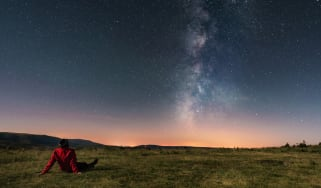 A young man lying on the grass and watching the Milky Way. Taken in A Veiga, Orense.