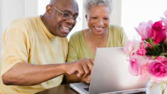 Couple using laptop computer