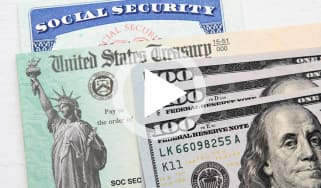 Partial view of Social Security card, US Treasury checks and hundred dollar bills. Finance and retirement concept.