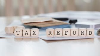 "picture of blocks spelling ""tax refund"""