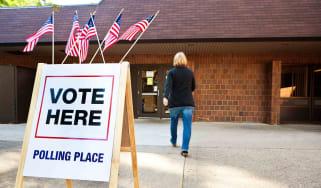 Woman walking inside polling place center