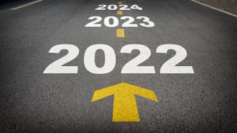 picture of a road with 2022, 2023, and 2024 written on it and an arrow pointing ahead