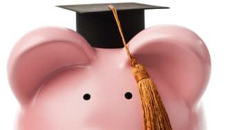 picture of a piggy bank with a graduation hat on its head