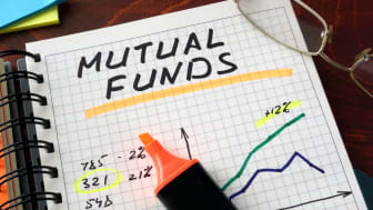 Notebook withmutual funds sign on a table. Business concept.