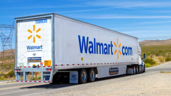 photo of Wal-Mart semi-trailer on highway.
