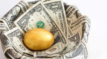 A single golden egg in a nest made from dollar bills isolated on white background.The single egg represents a single investment for the future, usually retirement or a college fund.