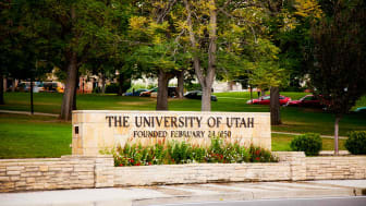 Late summer setting of one of the gateway entrances to the University of Utah--this one at the top of 2nd South Street in Salt Lake City, Utah. The landscaped quad and roadway surrounding this sign is known as President's Circle.