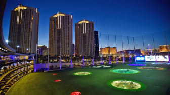 LAS VEGAS, NV - AUGUST 16:The sun sets over Las Vegas Strip hotels and Topgolf Las Vegas during the debut of SWINGDISH women's golf apparel 2017 spring/summer collection by designer Tricia Co