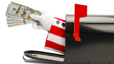 picture of Uncle Sam's arm sticking out of a mailbox and holding cash
