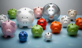 A group of piggy banks of many sizes and colors
