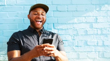 picture of excited man looking at his phone