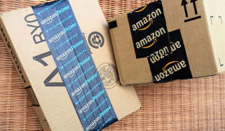West Palm Beach, USA - June 30, 2016: Amazon packing tape on Amazon.com shipping packages. One box is sealed with Amazon Prime packing tape.Amazon Prime is the premium subscription service th