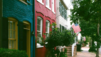 View from a residential street in Old Town Alexandria, Virginia, featuring early 1800s townhouses