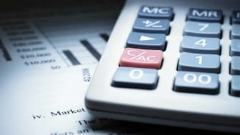calculator on sheet of financial papers