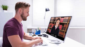 A person talks to a lawyer over the computer.