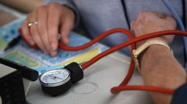 WISE, VA - JULY 25:A nurse checks a patient's blood pressure at the Remote Area Medical (RAM), healthcare clinic July 25, 2008 in Wise, Virginia. The free weekend clinic, staffed by more than