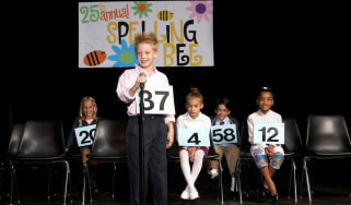 Kids compete in a spelling bee.