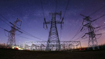 Power lines against a starry sky