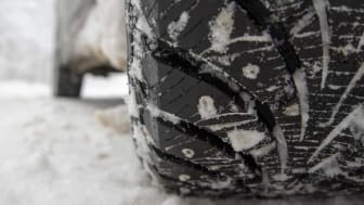 Photo of car with winter tires in snow