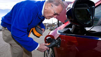 James Brazell - a retired oil company executive - gets a closer look at his new 2011 Chevrolet Volt electric vehicle Sunday, February 25, 2011 in Woodbridge, Virginia. Brazell placed his depo