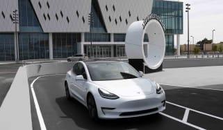A white Tesla vehicle