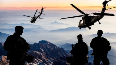 US soldiers with helicopters