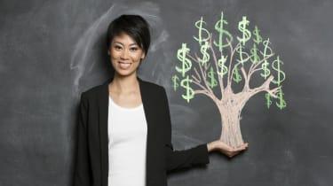 Asian woman and chalk money tree drawing on blackboard.