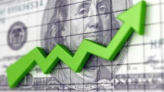 green arrow going up over $100 bill